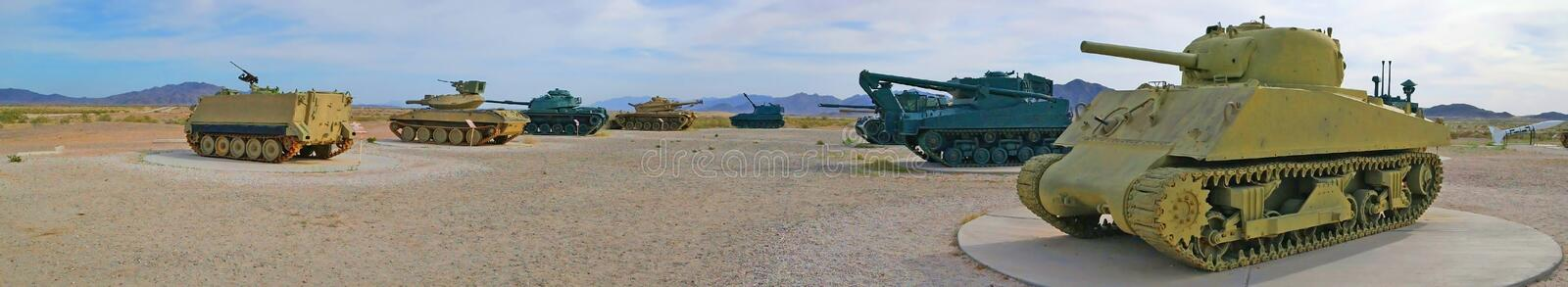 Old Military Tanks & Troop Carriers - Panorama. A panoramic view of a public display of old military tanks and troop carriers. Found near the Yuma Proving Ground royalty free stock images