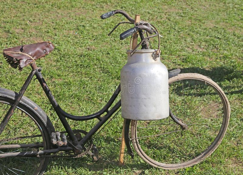 Old bicycle with aluminum milk canister stock photo