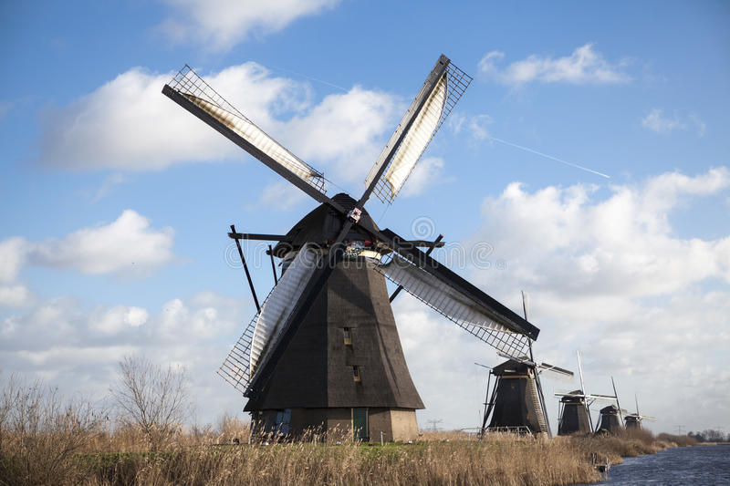 Old mill chalk and flour . The beautiful backdrop of the countryside of Holland. Holland windmill on a canal. Old mill chalk and flour . The beautiful backdrop stock image