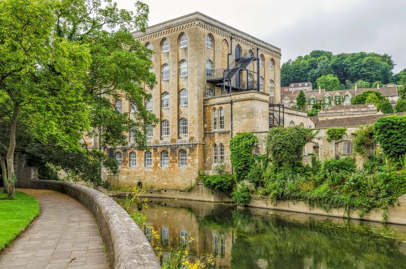 Old mill, River Avon, Bradford on Avon, Wiltshire, England. Exterior of old mill building on River Avon in Bradford on Avon, Wiltshire, England on sunny day stock photos