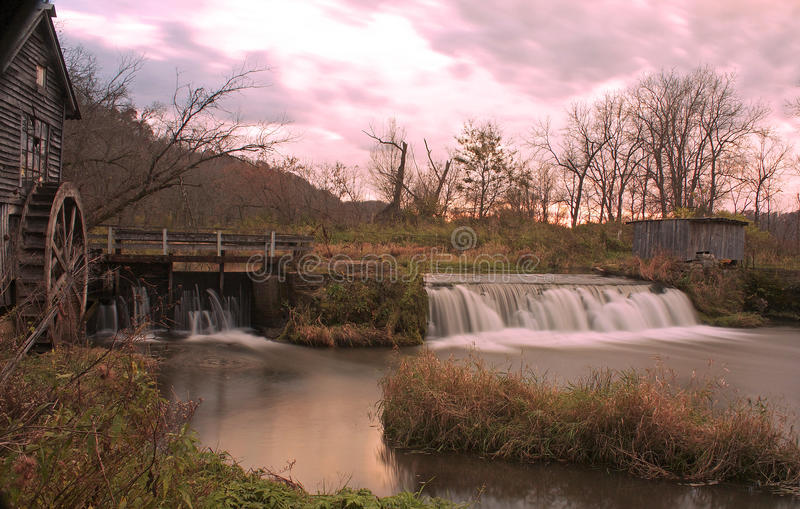Old mill at sunset royalty free stock image