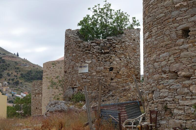 Old mill on Symi island - decaying royalty free stock image