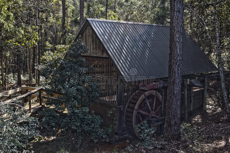 Old mill in the woods in HDR. royalty free stock images