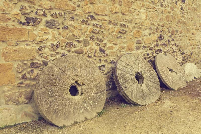 Old millstones with a vintage effect royalty free stock photo