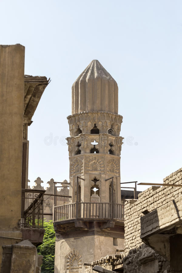 Old minaret of mosque against a bright blue sky, Islamic Cairo. Old minaret of mosque against a bright blue sky,Islamic Cairo, Egypt stock photography