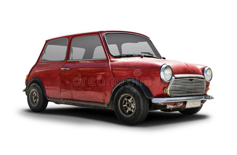 Old Mini Cooper. Old red Mini Cooper isolated on white royalty free stock images