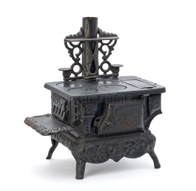 Old Miniature Stove. Isolated on a white background royalty free stock photo