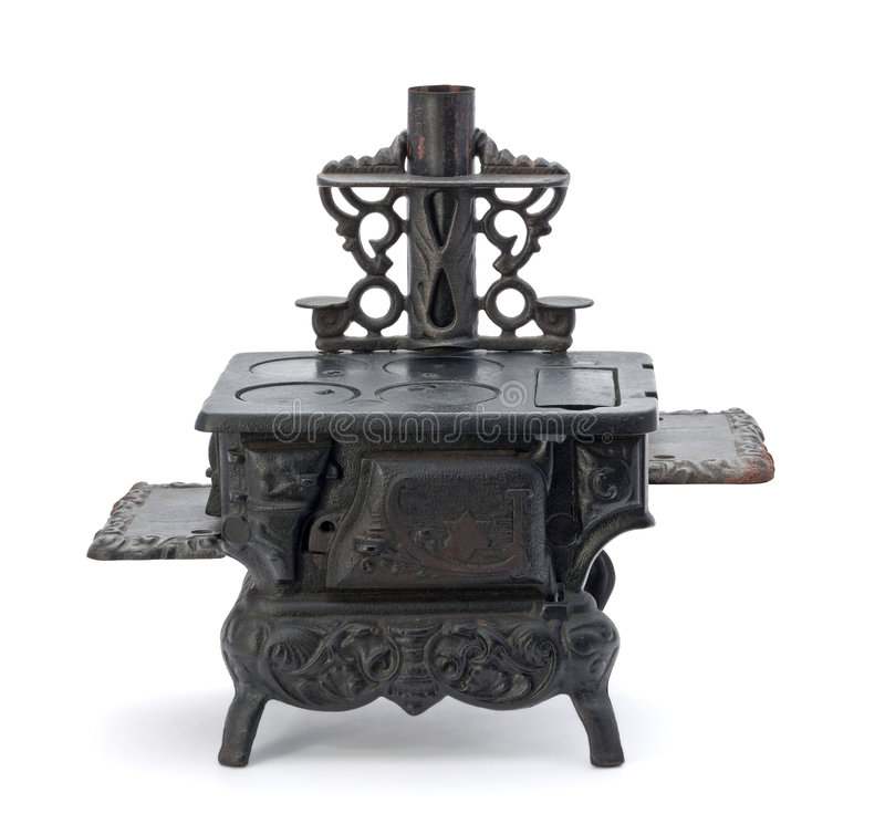 Old Miniature Stove. Isolated on a white background royalty free stock image