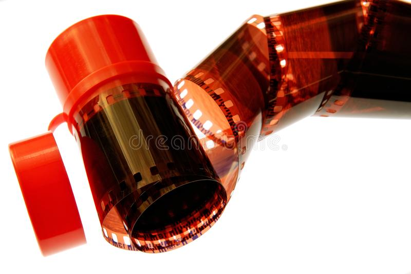 Old 35 mm film stripe spiral. Over white background stock photography