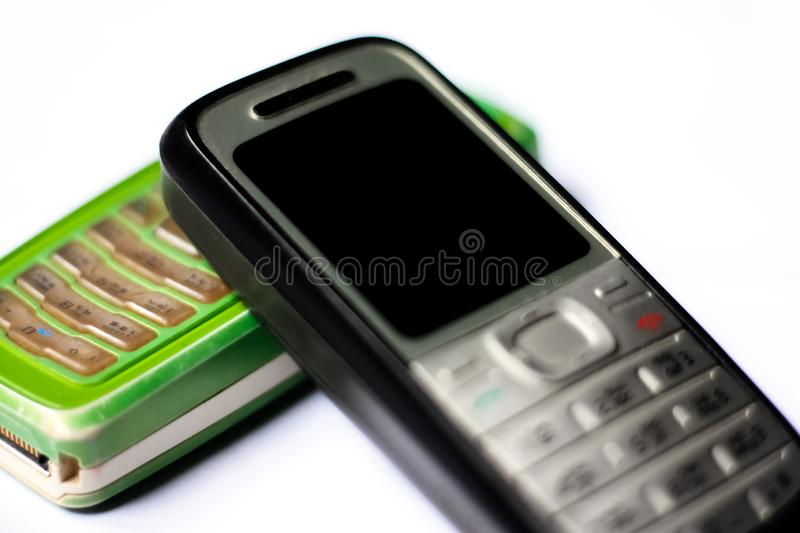 Old mobile phone on white background. royalty free stock images