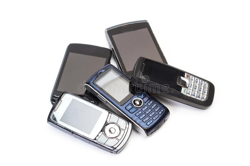 Old mobile phones in a cut out view stock photography