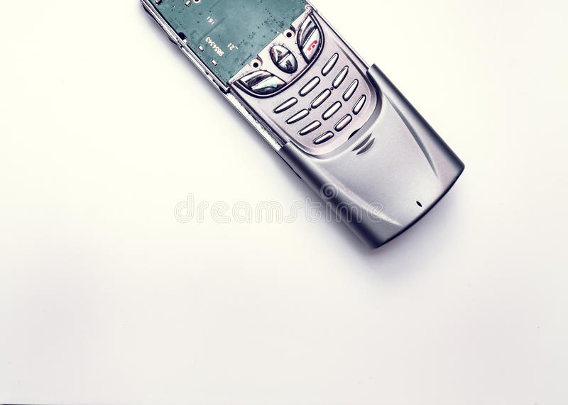 Old mobile phones Nokia with sliding lid and buttons without screen broken stock image