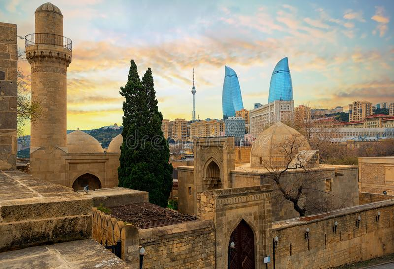 Old and modern architecture in Baku city, Azerbaijan. Baku city, Azerbaijan, view of the historical mosques and the walls of Shirvanshahs palace in the Old town royalty free stock photos