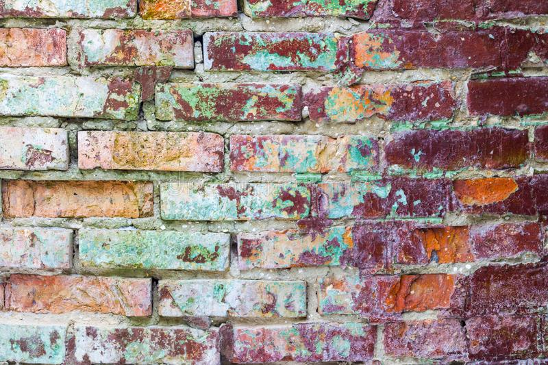 Old mold brick wall. Grunge colored brick wall background. Old brickwork decor backdrop. Architecture texture design royalty free stock photos