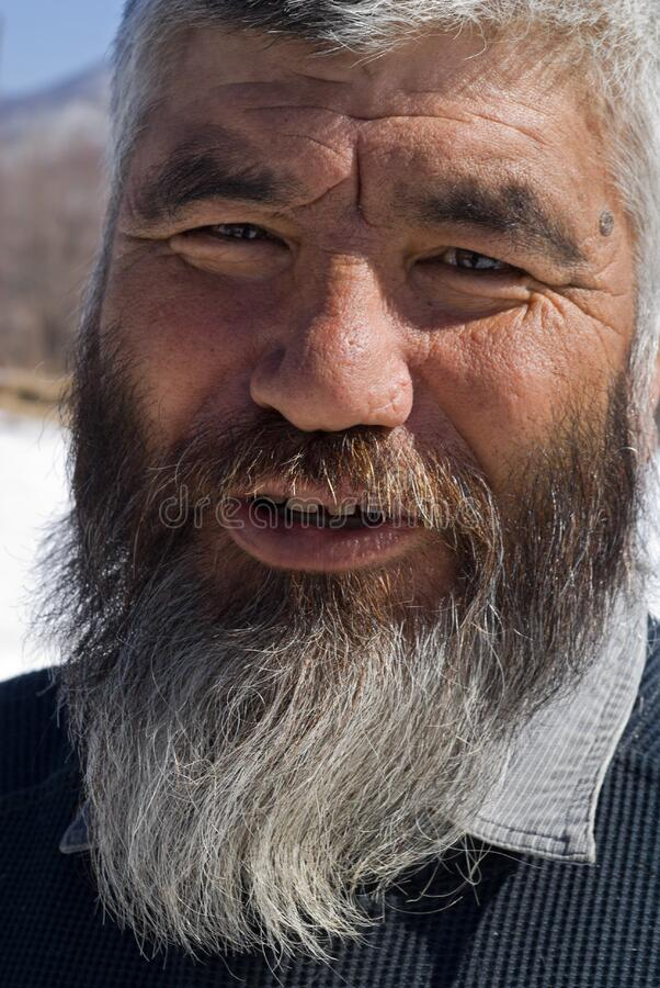 Old Mongoloid Man 15. A portrait close-up of the old men with grey beard. Small indigenous peope of Russian Far East royalty free stock image