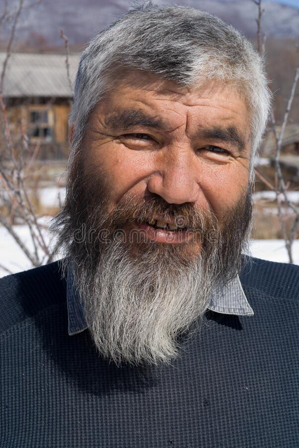 Old Mongoloid Man 20. A portrait close-up of the old men with grey beard. Small indigenous people of Russian Far East stock photography