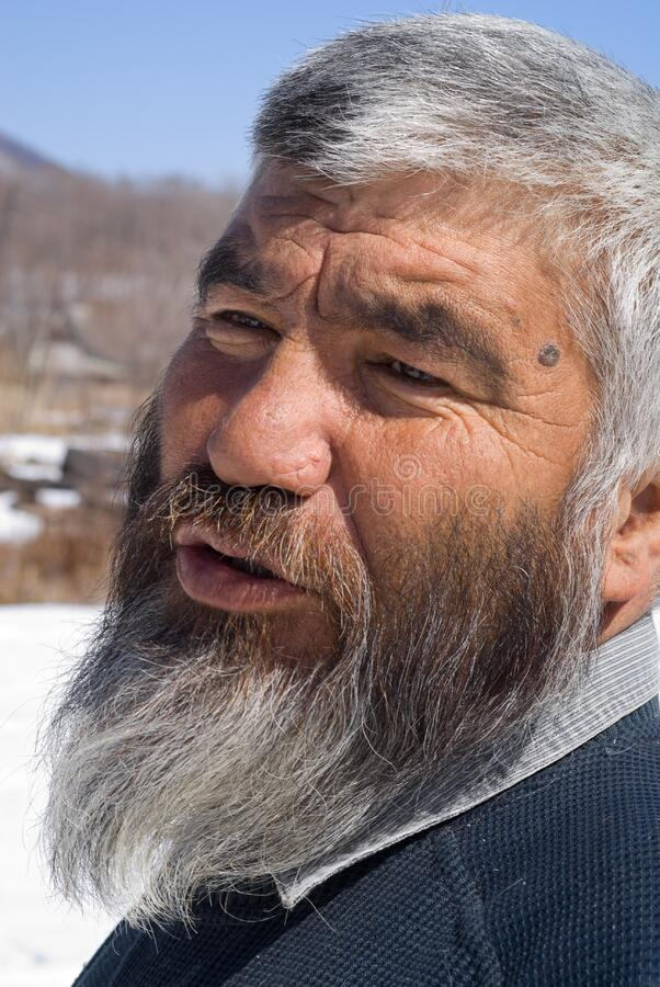 Old Mongoloid Man 33. A portrait close-up of the old men with grey beard. Small indigenous people of Russian Far East stock photos