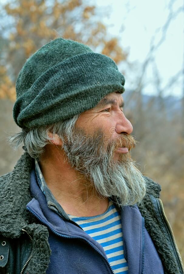 Old Mongoloid Man 34. A portrait of the old mongoloid man with grey beard stock photos
