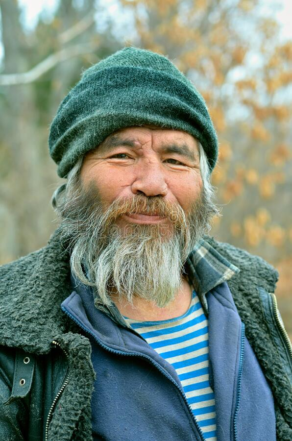 Old Mongoloid Man 36. A portrait of the old mongoloid man with grey beard stock photo