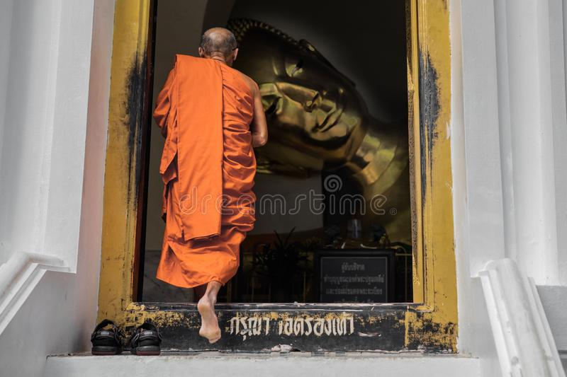 Old monk entering an ancient temple stock photo