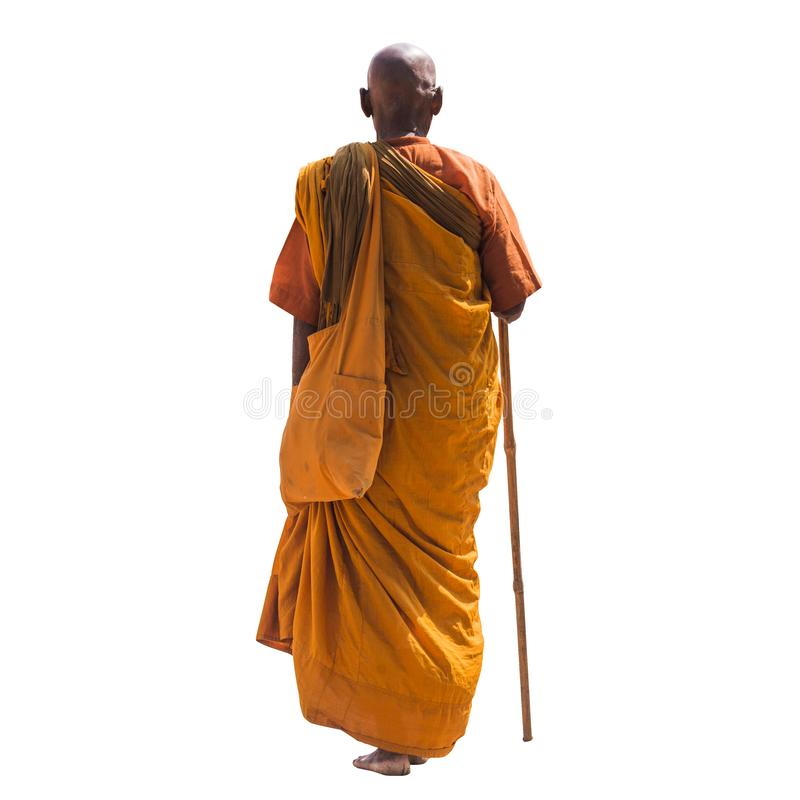 Old monk holding a walking stick stock photography