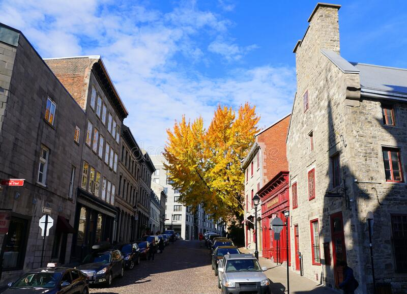 Old Montreal, Canada - October 27, 2019 - The view of the street, stores, restaurants and buildings in the city during Fall season stock photography
