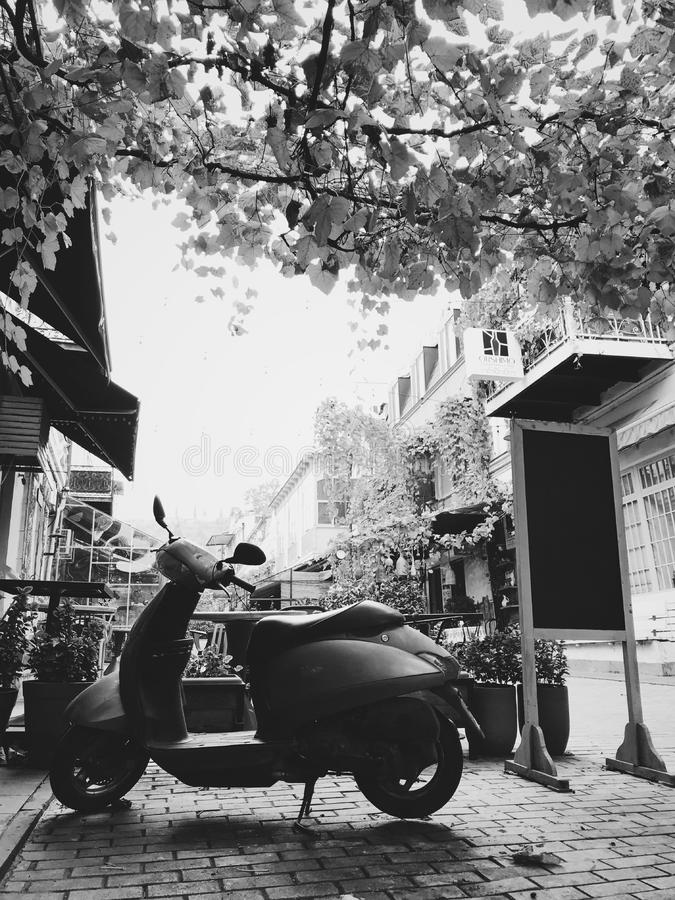 Old moped near caffee. Tbilisi, Georgia - december, 2018. Backyard in old town. Traditional georgian patio and old moped stock photo