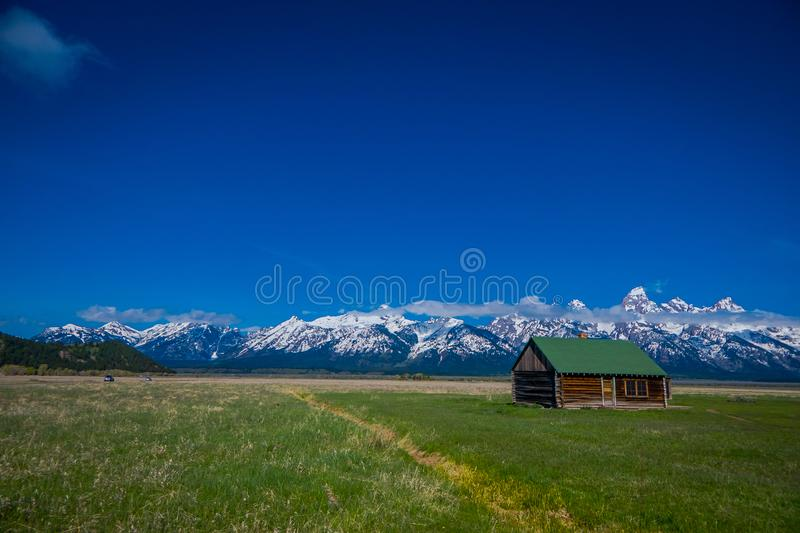Old mormon barn in Grand Teton Mountains with low clouds. Grand Teton National Park, Wyoming. USA stock photos