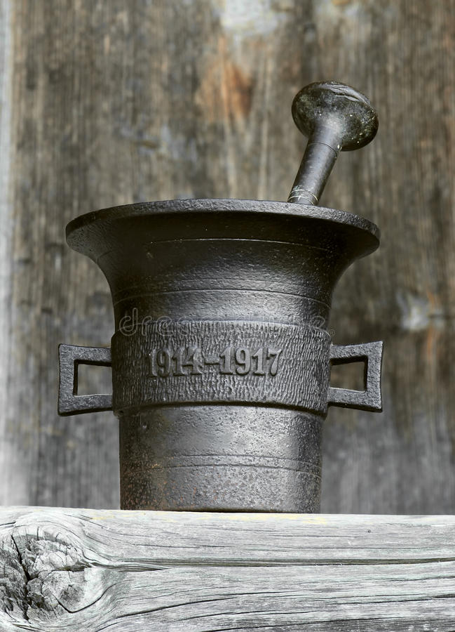 Old mortar. Old metal mortar on wooden background, aged 1914-1917 royalty free stock photography