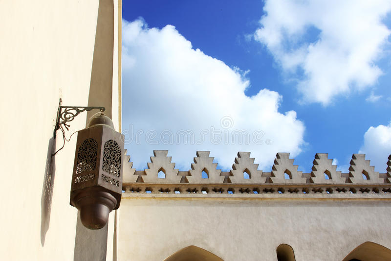 Old mosque in cairo in egypt. Wih cloudy blue sky background stock image