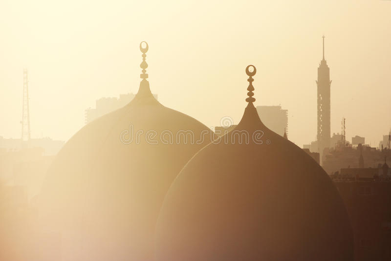 Old mosque and cairo tower. During sunset in old cairo in egypt stock photo