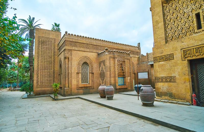 The stone mosque of Manial Palace, Cairo, Egypt. The old mosque of Manial Palace boasts outstanding architecture, intricate carved patterns on its stone walls royalty free stock photos