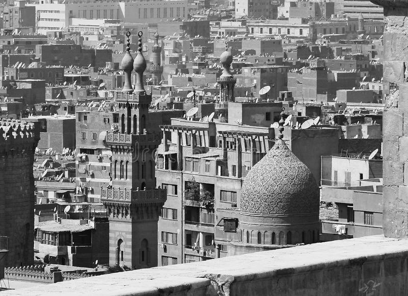 Old mosques in cairo in egypt. Minarets of old mosques with crowded houses in black and white in cairo in egypt stock photos