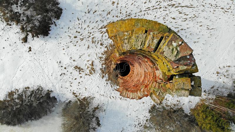 Old mossy tall brick chimney royalty free stock image