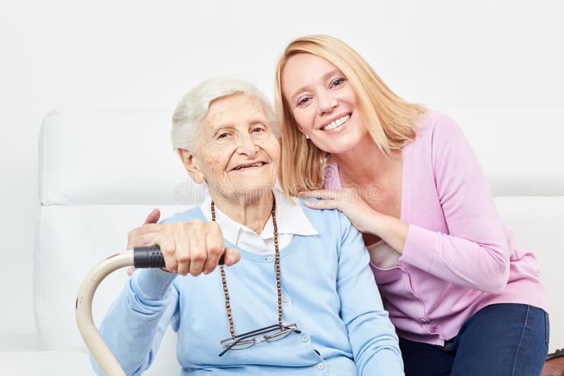 Old mother and daughter as a happy daughter royalty free stock photography