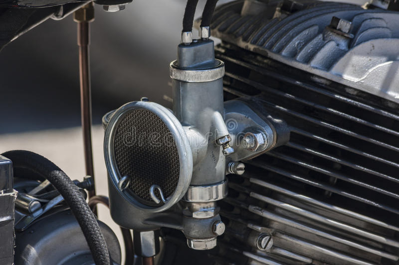 Old motor and its carburetor stock photos