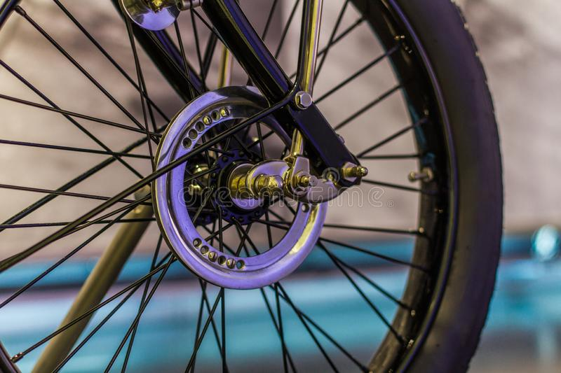 Old motorcycle wheels with polished spokes royalty free stock photos