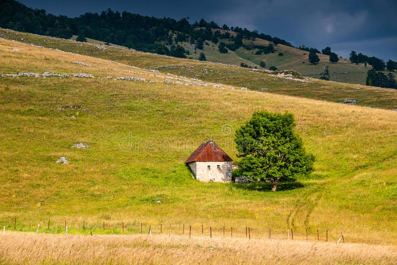 Old mountain balkan house in sunset, Bosnia and Herzegovina.  royalty free stock photo