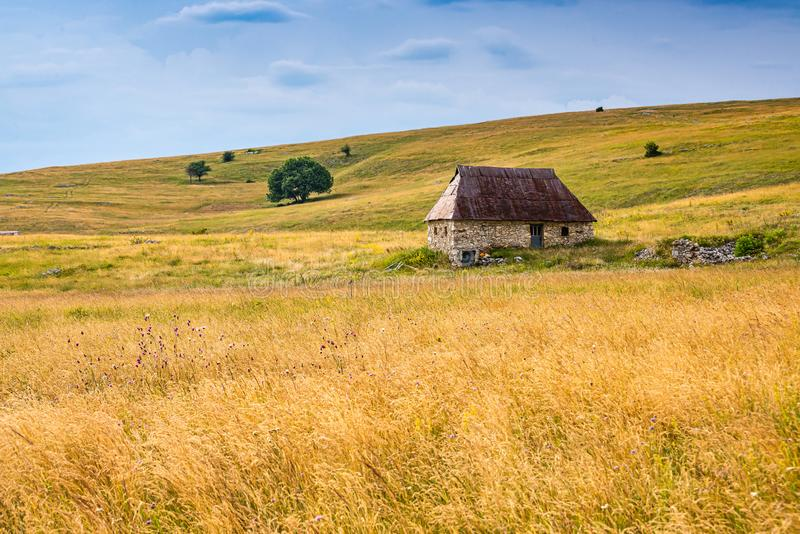 Old mountain balkan house in sunset, Bosnia and Herzegovina.  royalty free stock images