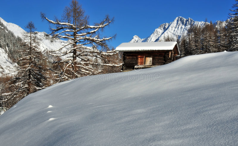 Old Mountain Cabin In The Snow Stock Photography