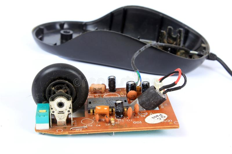 Old Mouse Technology. An old mouse with a wheel opened to show the technology used in it royalty free stock image