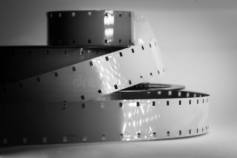 Old movie camera film reel strip. Black and white colors stock photo