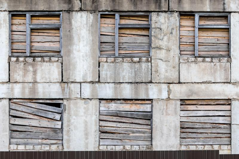 Old multi-storey gray boarded up wooden worn-out building stock photography
