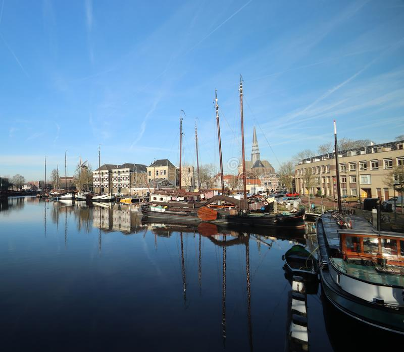 Old museum harbor of Gouda with historic ships at mallegatsluis sluice to the Hollandsche IJssel in the Netherlands. royalty free stock photo