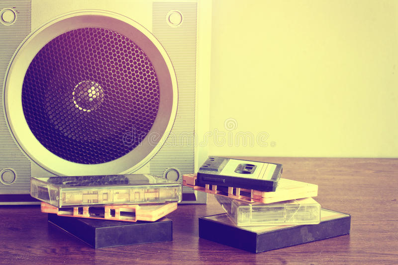 Old music speaker, heap of audio cassettes royalty free stock image
