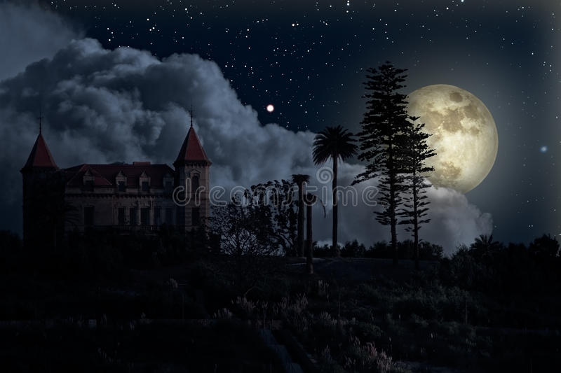 Old mysterious house in a full moon night stock photos