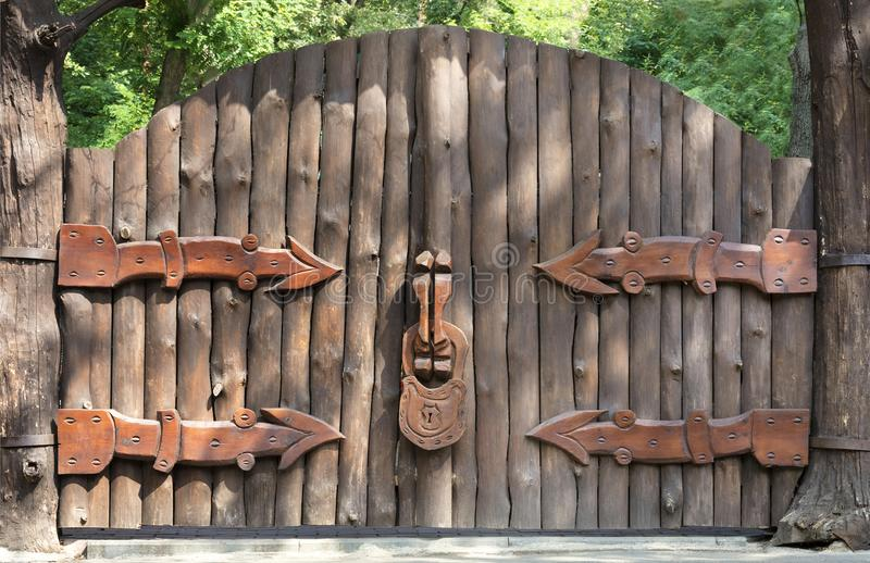 Old and mysterious wooden gate - entrance to the magic forest stock images