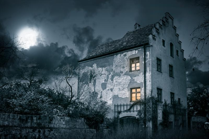 Old mystic villa in moonlight royalty free stock image