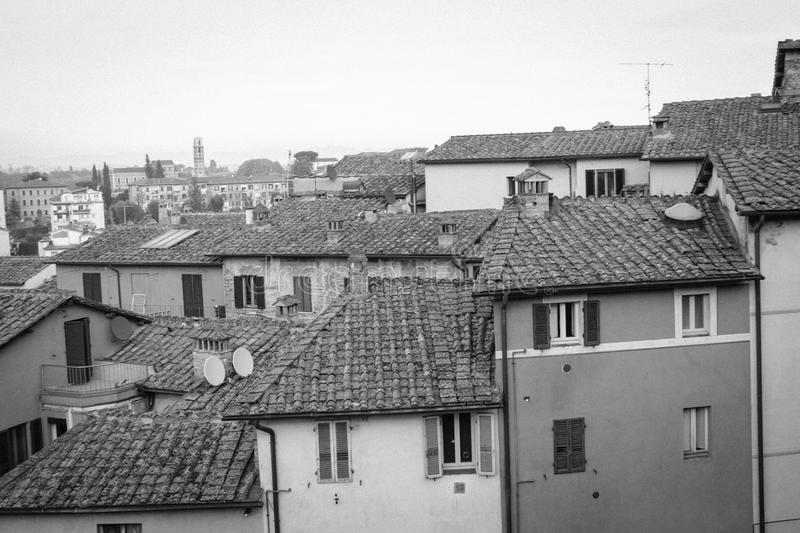 Old narrow buildings in Siena, Tuscany, Italy. Black and white. stock photography