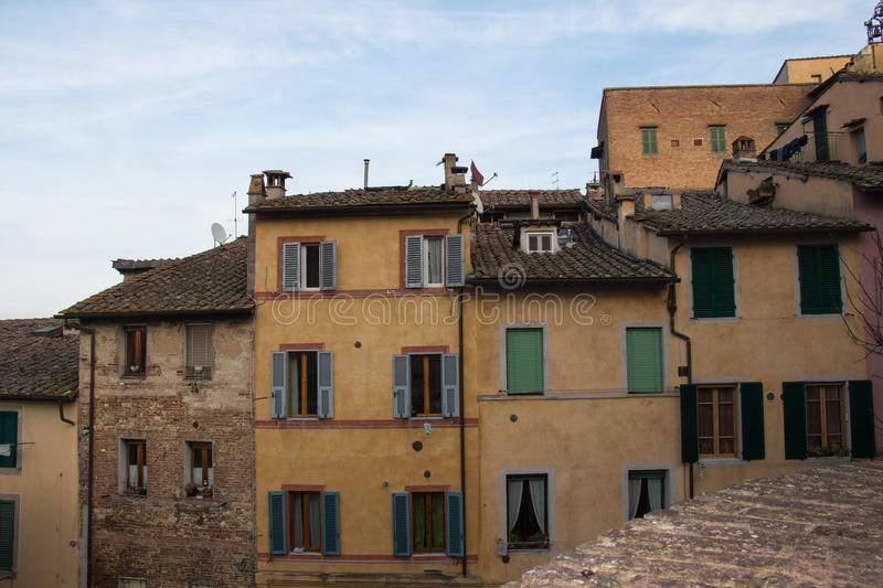 Old narrow buildings in Siena, Tuscany, Italy. royalty free stock images